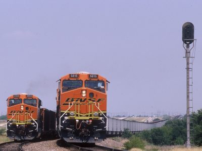 two-bnsf-locomotives-hauling-coal-trains-meet-near-wichita-falls-texas