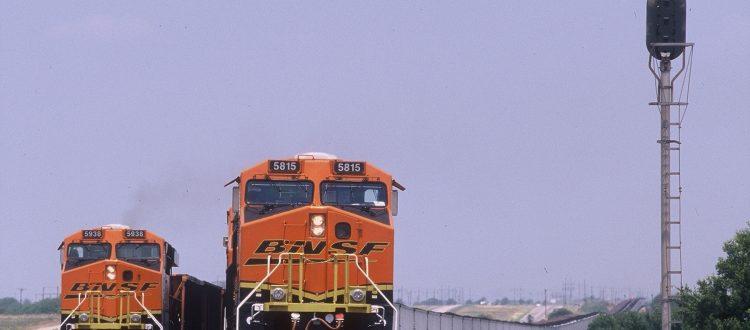 two-bnsf-locomotives-hauling-coal-trains-meet-near-wichita-falls-texas